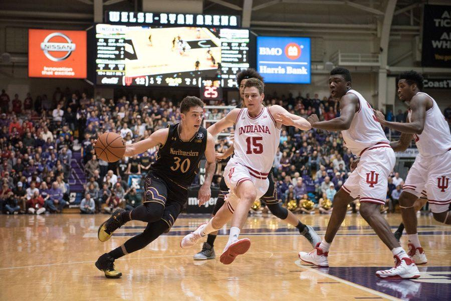 Bryant+McIntosh+drives+past+defenders.+The+junior+guard+will+look+to+lead+Northwestern+back+on+the+winning+track+against+Illinois.