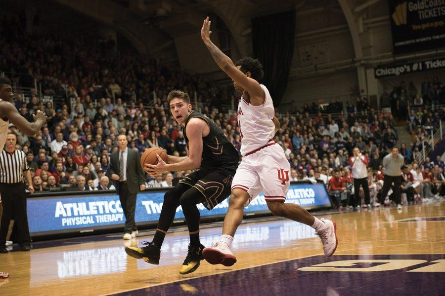 Bryant McIntosh handles the ball. The junior guard's 22 points weren't enough for No. 25 Northwestern against No. 23 Purdue.