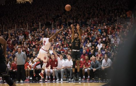 Isiah Brown attempts a shot. The freshman logged his first career start but struggled to find an offensive rhythm in the Wildcats' 21-point loss.