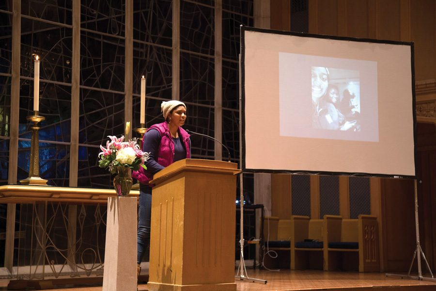 Christen Johnson (Medill '16) speaks at a memorial for Weinberg sophomore Jordan Hankins. The memorial was held at Alice Millar Chapel on Wednesday night.