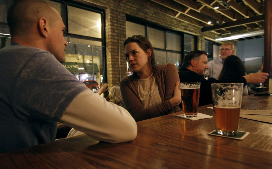 Customers drink a beer at Peckish Pig, 623 Howard St. The management of the pub decided to close down on Thursday for the