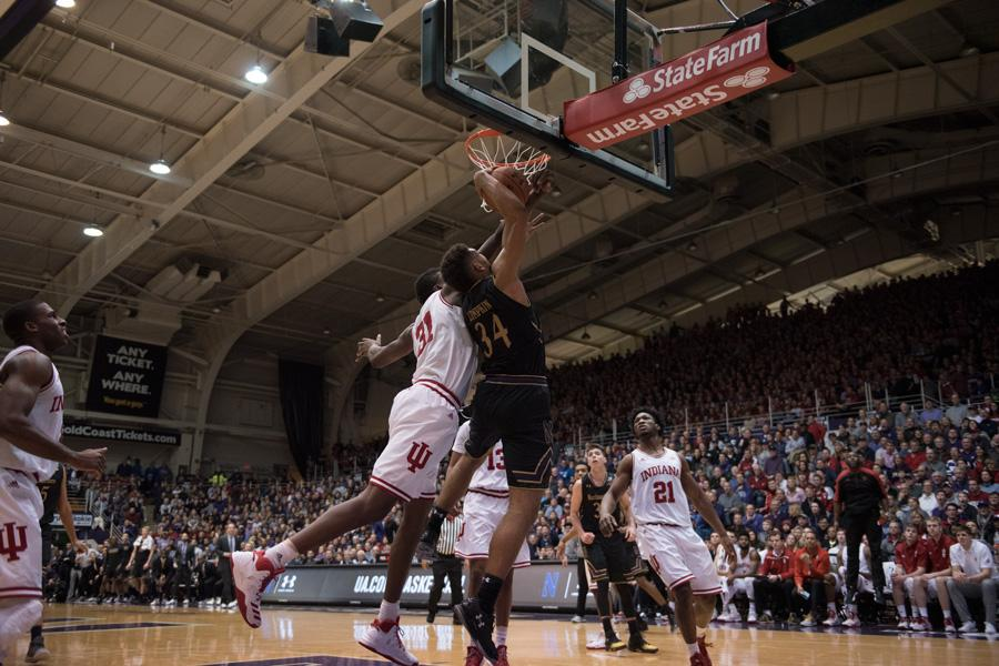 Sanjay Lumpkin is contested at the rim. The senior forward struggled against Purdue's size in Northwestern's blowout loss Wednesday.