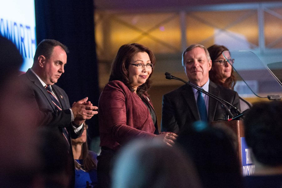 Sen. Dick Durbin looks on at then-Representative Tammy Duckworth as she accepts victory in her race for the Senate in November. Both senators voted against Secretary of State Rex Tillerson today.