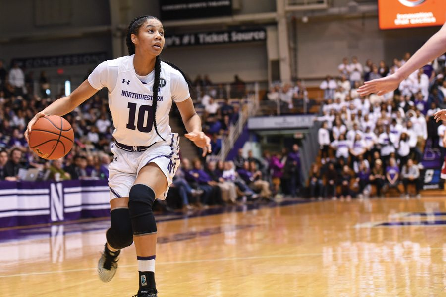 Nia+Coffey+handles+the+ball.+The+senior+forward+tallied+28+points+and+17+rebounds+against+in+the+Wildcats%E2%80%99+loss+to+the+Nittany+Lions+on+Sunday.