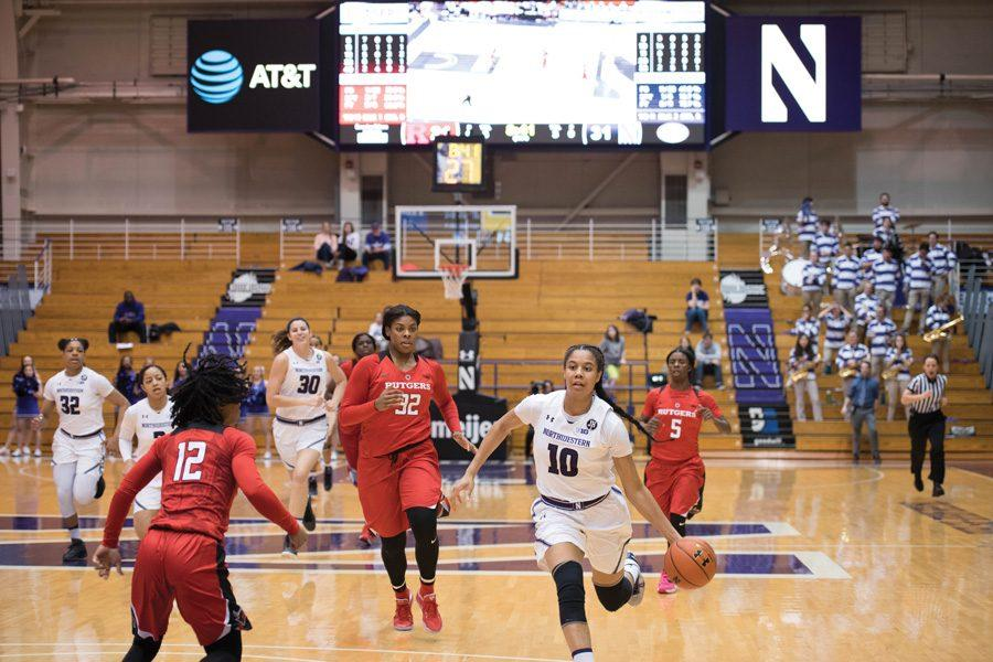 Nia+Coffey+drives+to+the+basket.+The+senior+forward%E2%80%99s+27+points+led+the+Wildcats+to+their+victory+over+Rutgers.+
