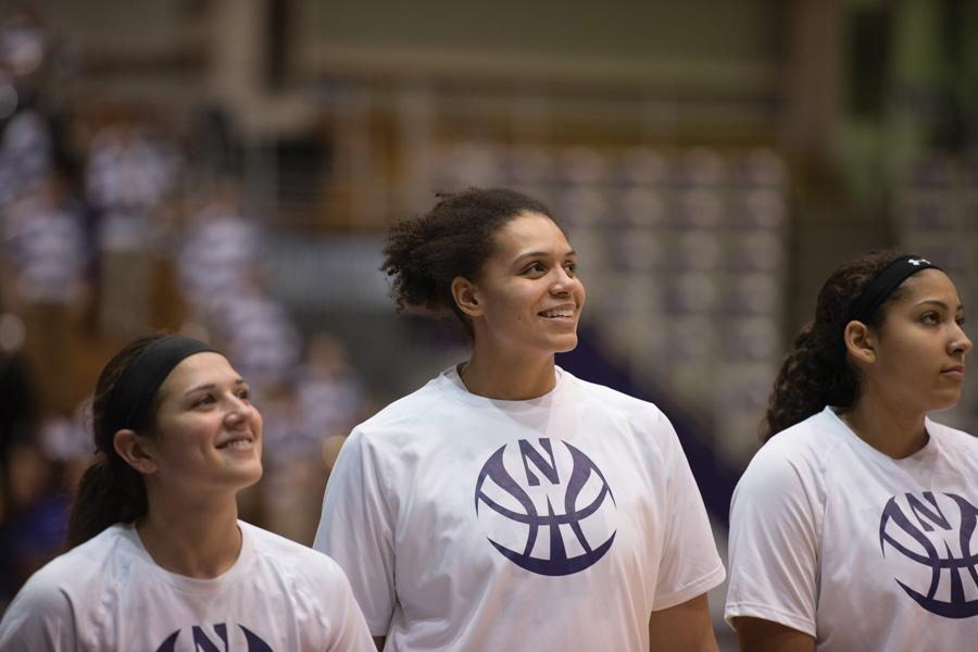 Oceana Hamilton smiles alongside her teammates. The junior center gave Northwestern a boost on the boards, though the team struggled overall to rebound against Iowa.