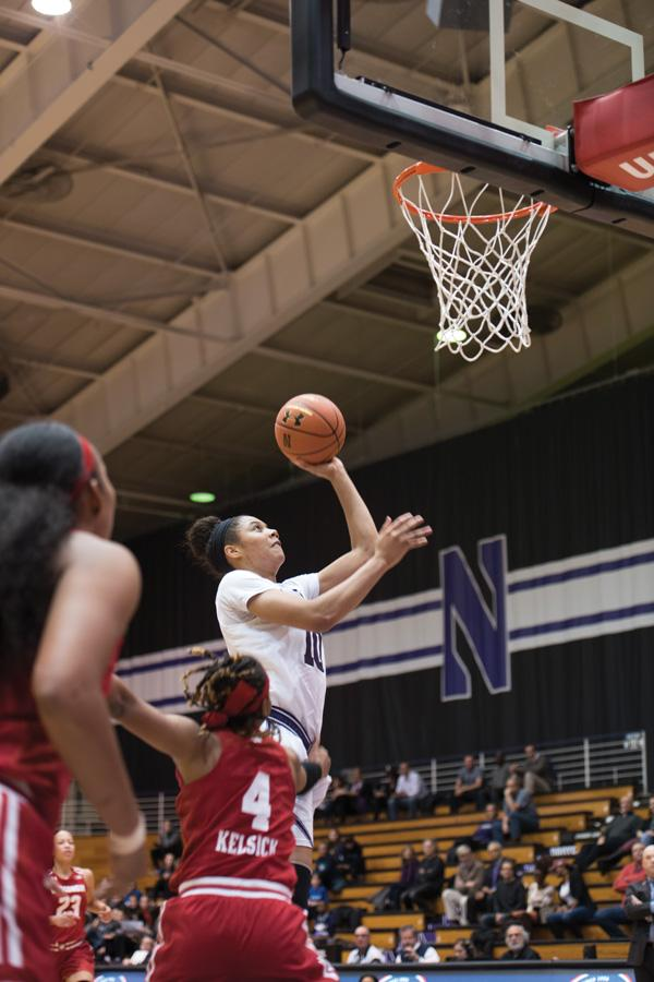 Nia Coffey skies for a layup. The forward was honored alongside her fellow seniors prior to Sunday's win.