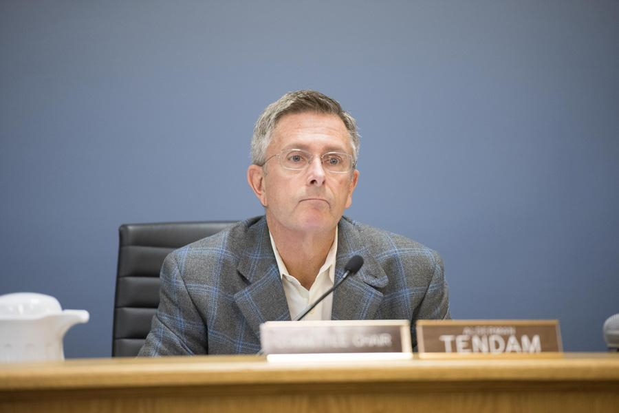 Ald. Mark Tendam (6th) at a city meeting Monday night. After eight years on City Council, Tendam is one of five candidates vying to be Evanston's next mayor.