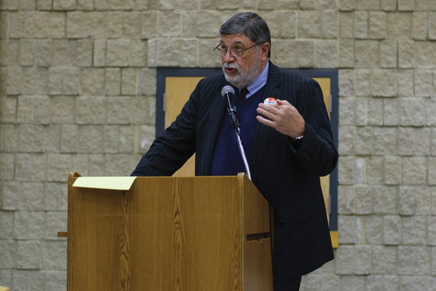 "Cook County Commissioner Larry Suffredin, who represents Evanston, speaks at a town hall event Thursday. Suffredin urged attendees to continue to believe in the ""integrity"" of the current election process at the event."