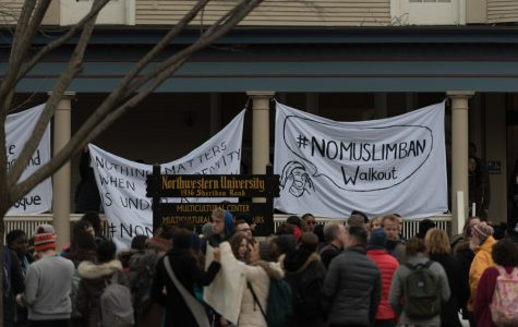 Protesters gather outside the Multicultural Center on Wednesday to demonstrate against President Trump's recent immigration action. The event, titled #NoMuslimBan Walkout, was organized by Immigrant Justice Project and various other groups on campus.