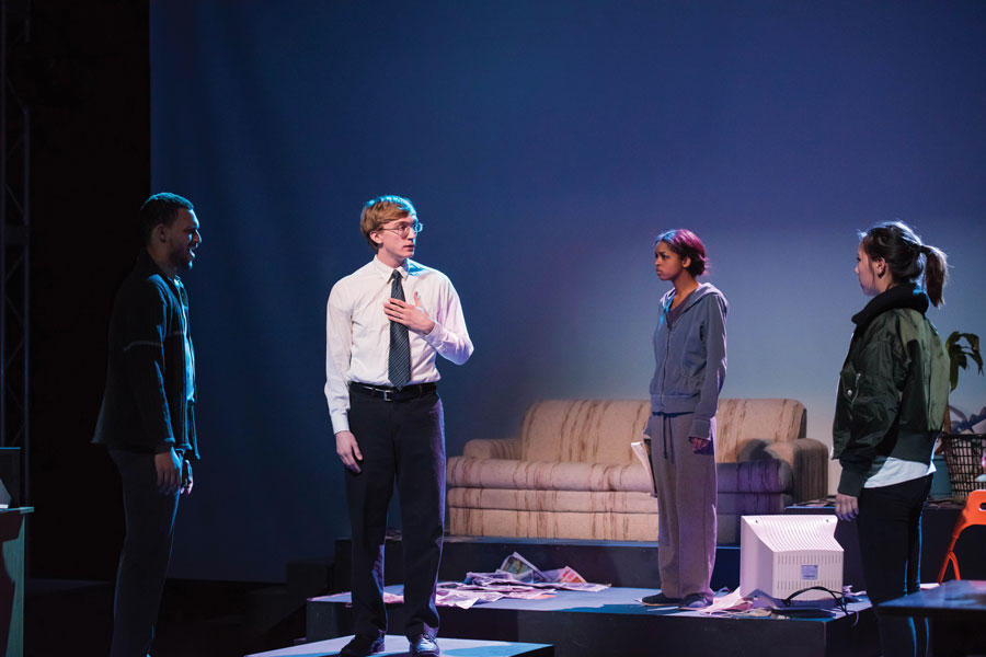 "In ""Water By The Spoonful,"" characters in the internet chat room stand on separate platforms to represent their physical separation. The play, which deals with issues of drug addiction and death through this chat room setting and through a Puerto Rican-American family, opens Friday in McCormick Auditorium."