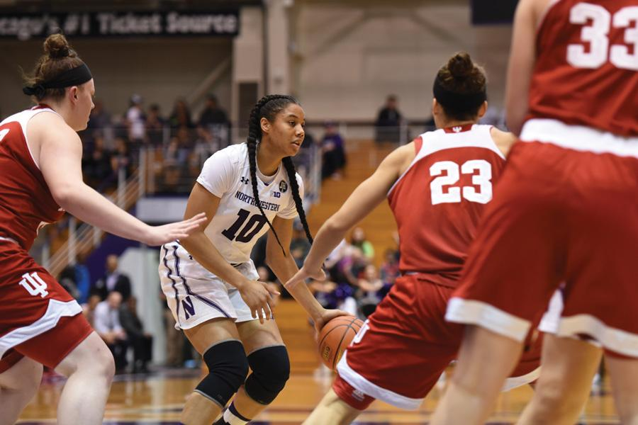Nia Coffey dribbles through defenders. The senior will look to lead Northwestern through its home stretch.