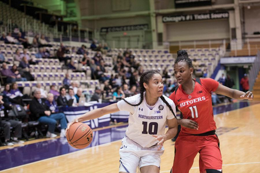 Nia Coffey drives toward the hoop. The senior forward scored 27 points in the Wildcats' win over Rutgers.