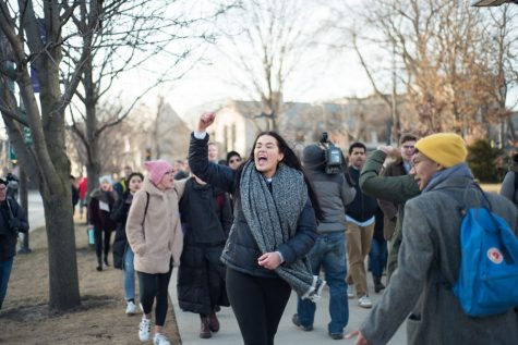 Students march to SAE headquarters demanding removal of NU chapter's membership after assault, drugging allegations
