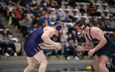 Jacob Berkowitz squares off with an opponent. The senior recorded a pair of wins in the Wildcats' split weekend.
