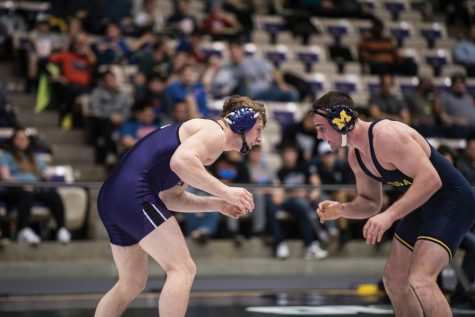 Wrestling: Wildcats split pair of road duals to close the season