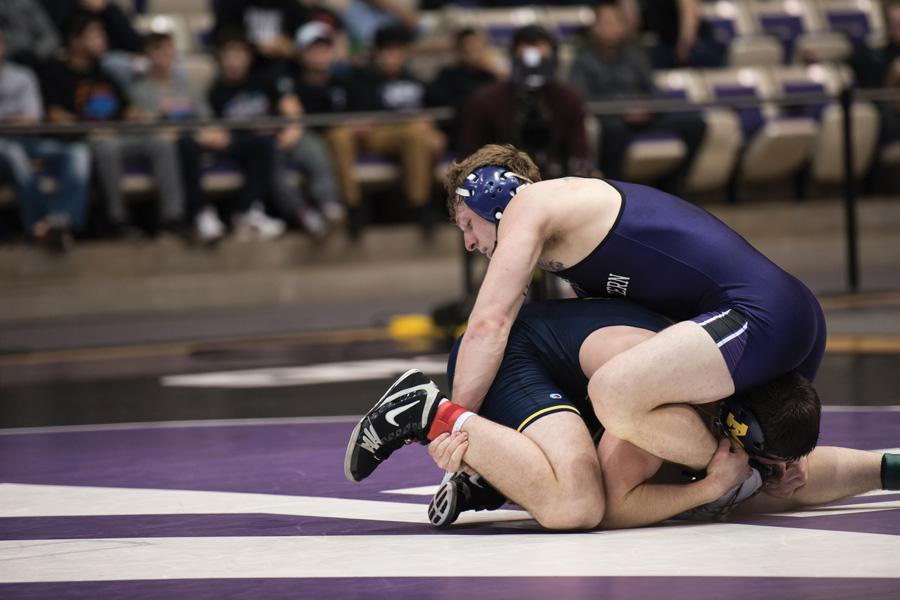 Jacob Berkowitz grapples with his opponent. The senior will close out his home career on Senior Day this weekend.