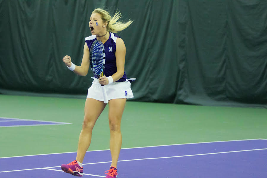 Alex Chatt celebrates a point. The junior logged two wins but Northwestern dropped its weekend matches.