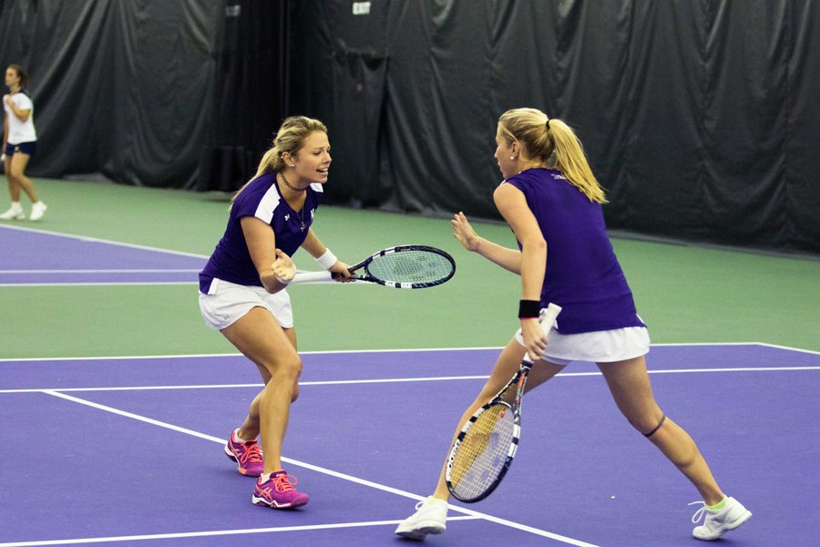 Alex Chatt and Maddie Lipp celebrate a point. The doubles duo notched a pair of wins over the weekend.