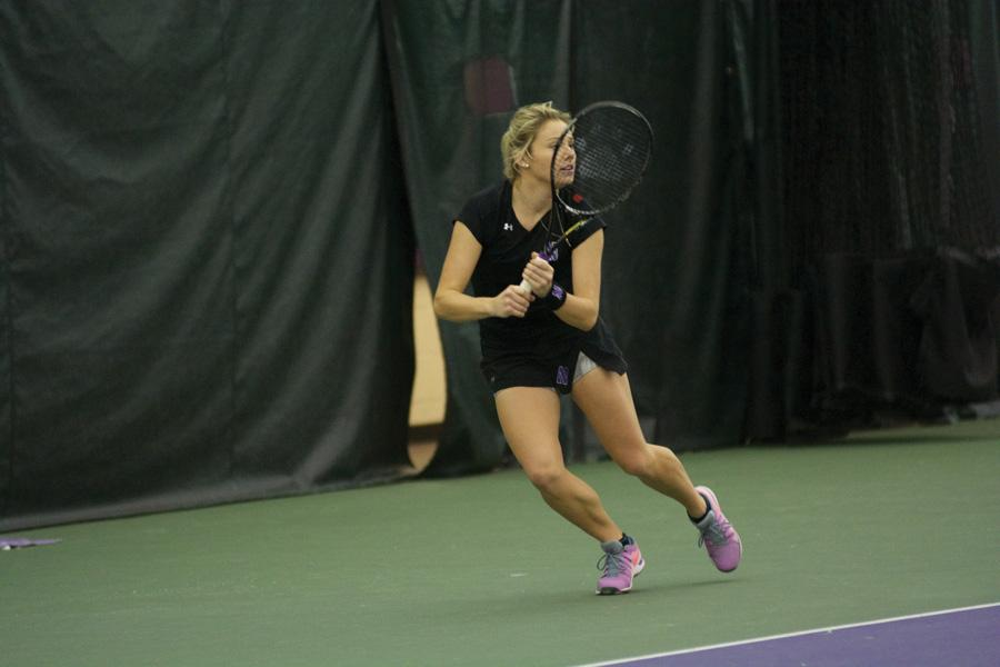 Alex Chatt looks to return the ball. The junior is undefeated at No. 5 singles this season.