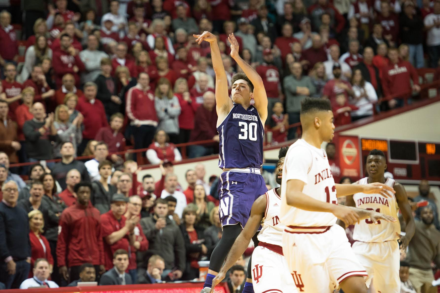 Bryant McIntosh attempts a game-winner. The junior guard's miracle heave bounced off the rim Saturday as the Wildcats lost a heartbreaker in Indiana.