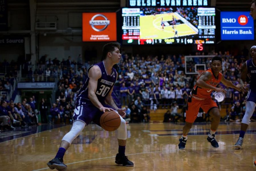 Bryant McIntosh dribbles the ball. The junior guard's 21 points weren't enough to lead Northwestern over Illinois.