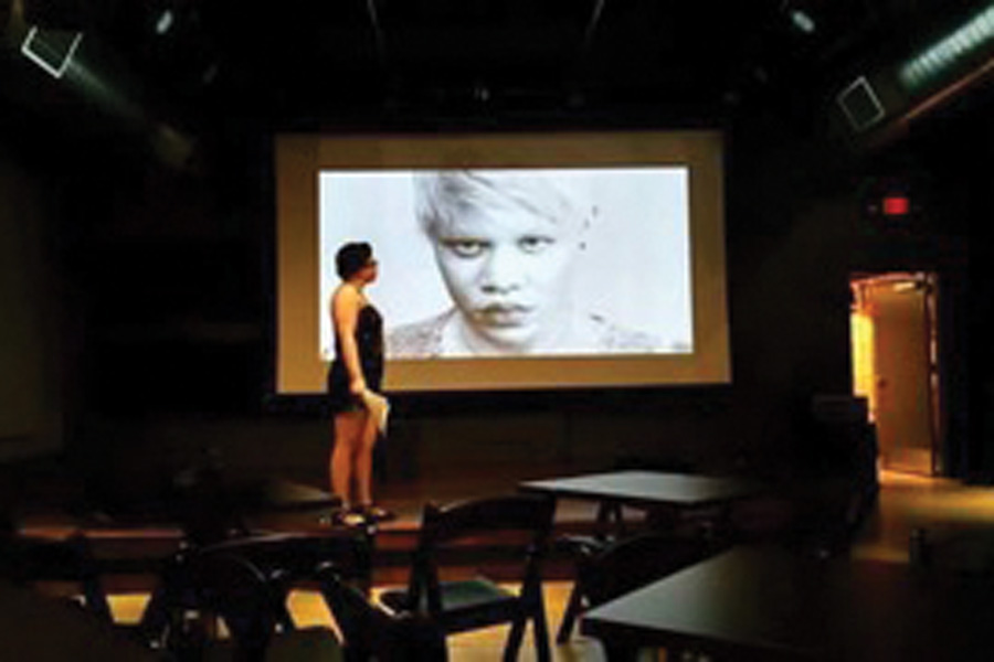 "Northwestern staff member Ashley Hicks performs her one-woman show, ""Beautifully Broken Pieces."" The show focuses on Hicks' albinism and incorporates singing, dancing and a PowerPoint slide."