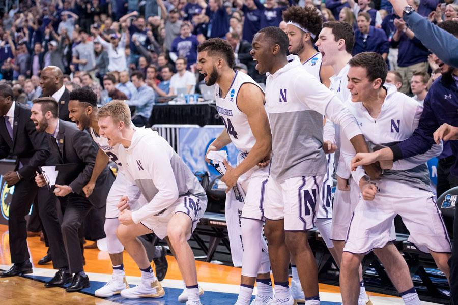 Northwestern's bench celebrates. In their first NCAA Tournament appearance in program history, the Wildcats topped Vanderbilt.