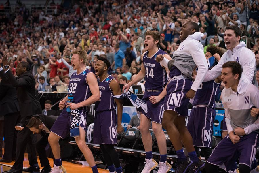 Northwestern's bench celebrates. Despite playing in a neutral arena, the Wildcats had plenty of support in Salt Lake City during the first two rounds of the NCAA Tournament.