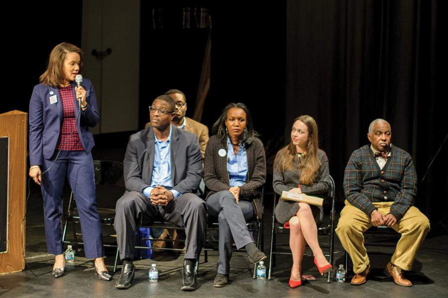 Robin Rue Simmons speaks at a candidate forum on Jan. 19. She and Carolyn Murray, seated second from the left, will face off in the general election on April 4.
