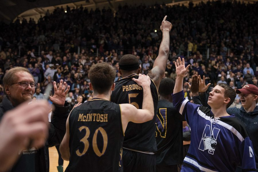 Dererk Pardon celebrates with teammates. The sophomore center's game-winner lifted Northwestern past Michigan.