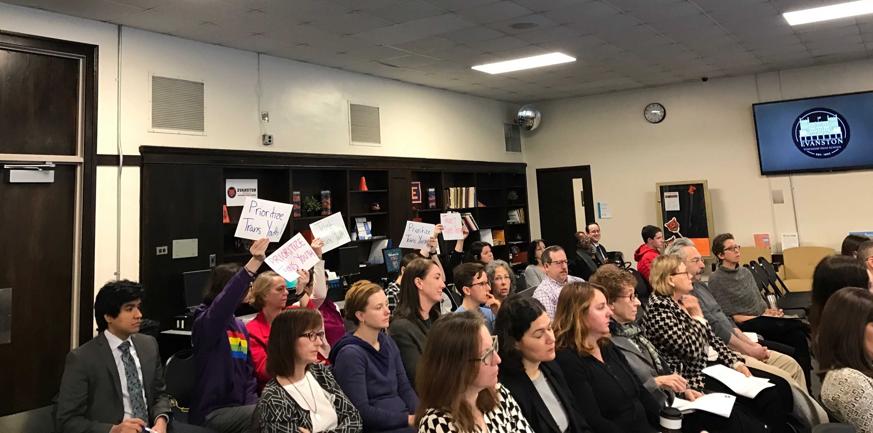 Community members attend a District 202 School Board Policy Committee meeting Thursday. The committee decided at the meeting to draft new language that would allow transgender students to use the locker room that aligns with their gender.