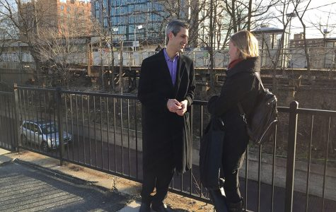 State Sen. Daniel Biss (D-Evanston) speaks to a supporter at a