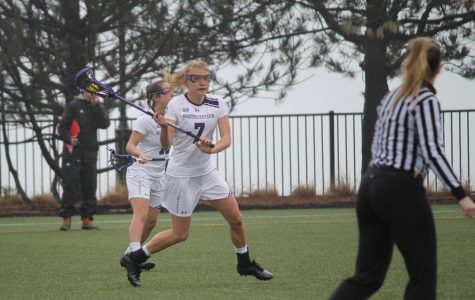 Sheila Nesselbush brings the ball up the field. The junior midfielder and the Wildcats look to extend their winning streak Thursday against Johns Hopkins.