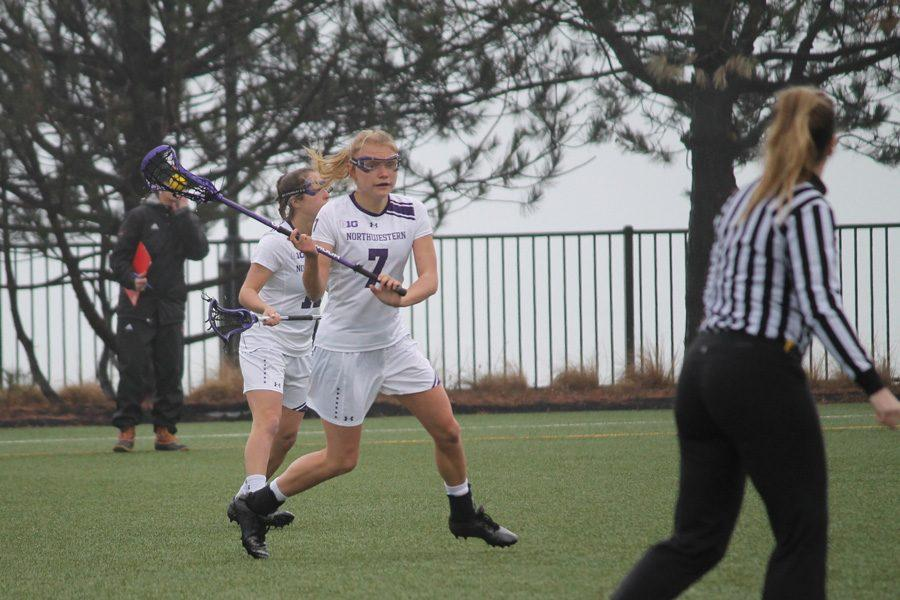 Sheila+Nesselbush+brings+the+ball+up+the+field.+The+junior+midfielder+and+the+Wildcats+look+to+extend+their+winning+streak+Thursday+against+Johns+Hopkins.