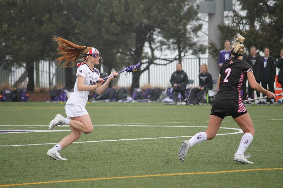 Claire+Quinn+brings+the+ball+up+the+field.+The+sophomore+defender+scored+her+first+career+goal+in+NU%E2%80%99s+win+Sunday.