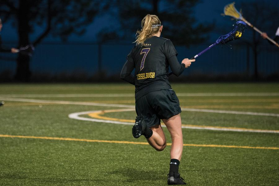 Sheila Nesselbush races up the field. The junior midfielder scored a dramatic goal to send Thursday's game to overtime, which the Wildcats eventually won.