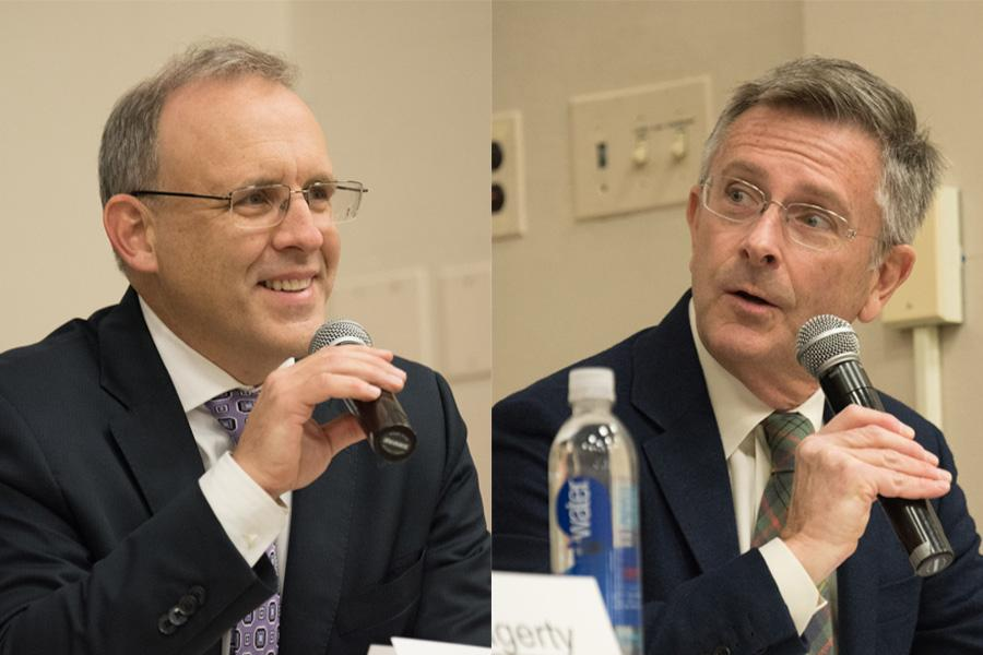 Businessman Steve Hagerty and Ald. Mark Tendam (6th) speak Feb. 7 at a mayoral debate. The two candidates have started to shift the focus of their campaigns toward next month's general election.