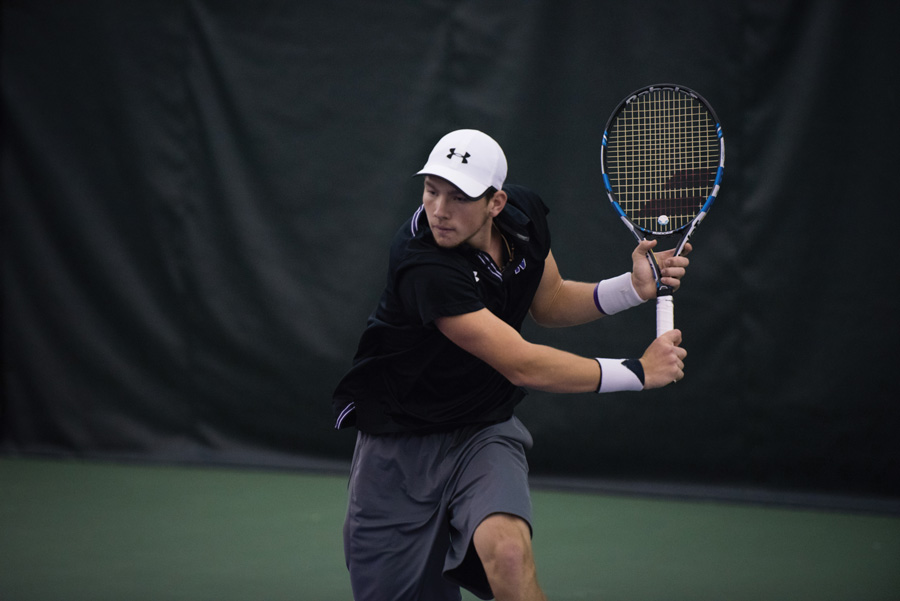 Strong Kirchheimer fire a backhand. The senior helped lead the Cats to a pair of weekend victories.