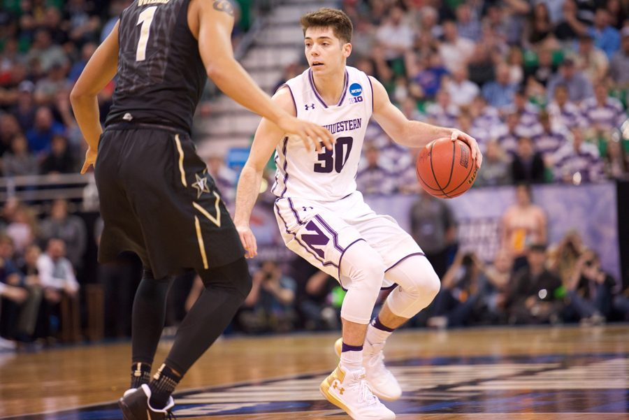 Bryant+McIntosh+handles+the+ball.+The+junior+guard+scored+25+in+Northwestern%27s+first-round+win+over+Vanderbilt.