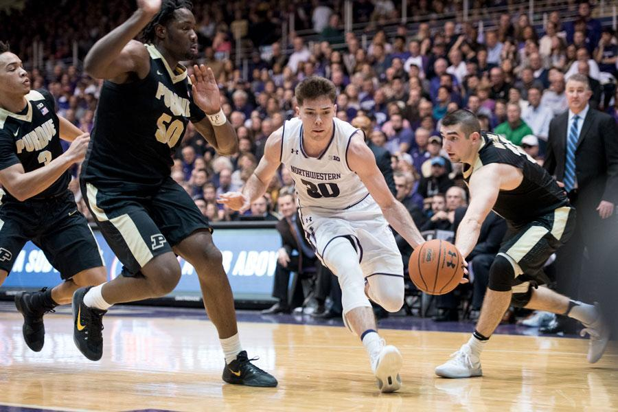 Bryant McIntosh drives through traffic. The junior guard scored 25 points and handed out six assists in Northwestern's narrow loss to Purdue.