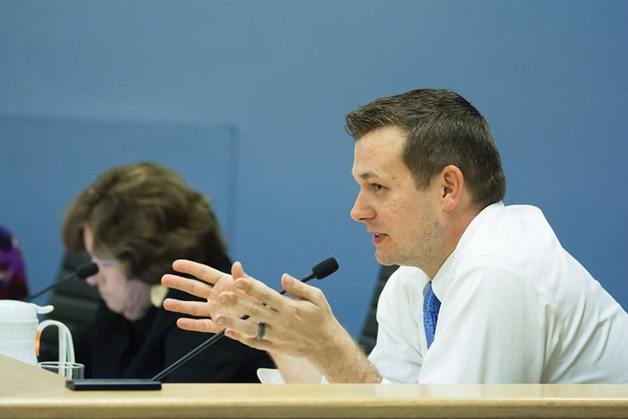 Ald.+Brian+Miller+%289th%29+attends+a+City+Council+meeting.+At+a+meeting+Monday+night%2C+Miller+responded+to+residents%27+concerns+about+Evanston+Now%2C+a+news+website.