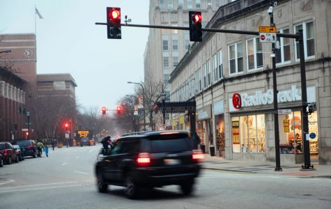 A car runs a red light on the intersection of Sherman Ave. and Church St. Chicago will be relocating six red light cameras and increasing the grace period for running a red light in response to a study held by the Northwestern Transportation Center.