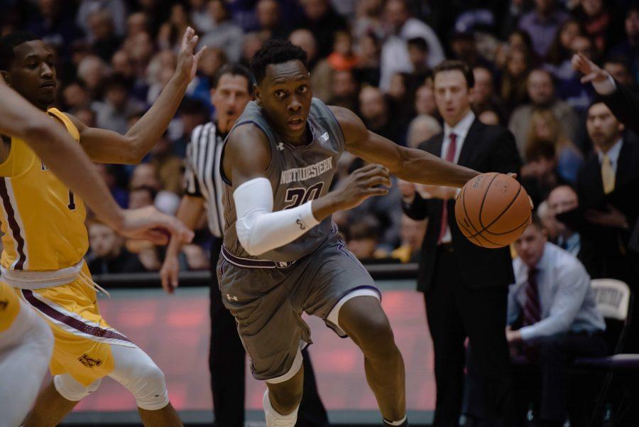 Scottie Lindsey dribbles to his left. The junior guard shook a late-season slump and scored 16 points against Rutgers.