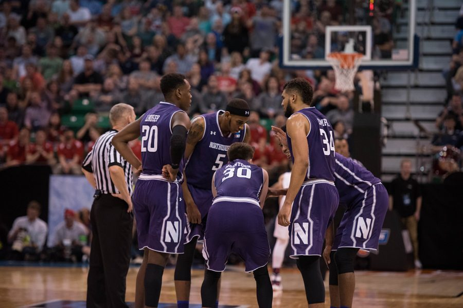 Northwestern%27s+starters+huddle+at+half+court.+Four+of+the+team%27s+starters+will+return+in+2017-18+as+the+Wildcats+look+to+build+on+their+recent+success.%0A