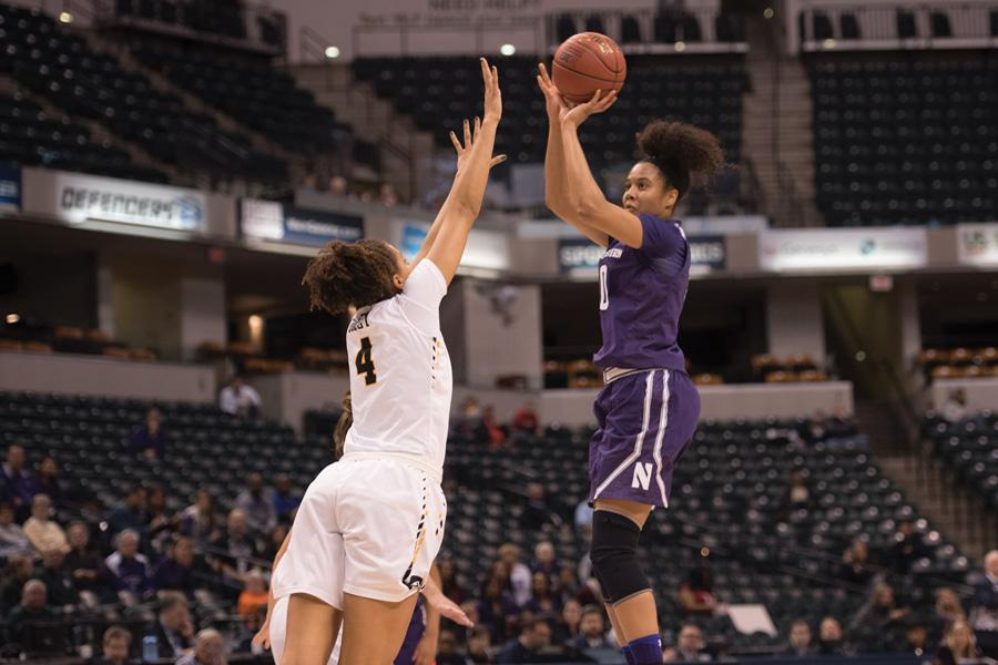 Nia Coffey shoots over a defender. The senior exploded for 34 points to lead Northwestern to victory.