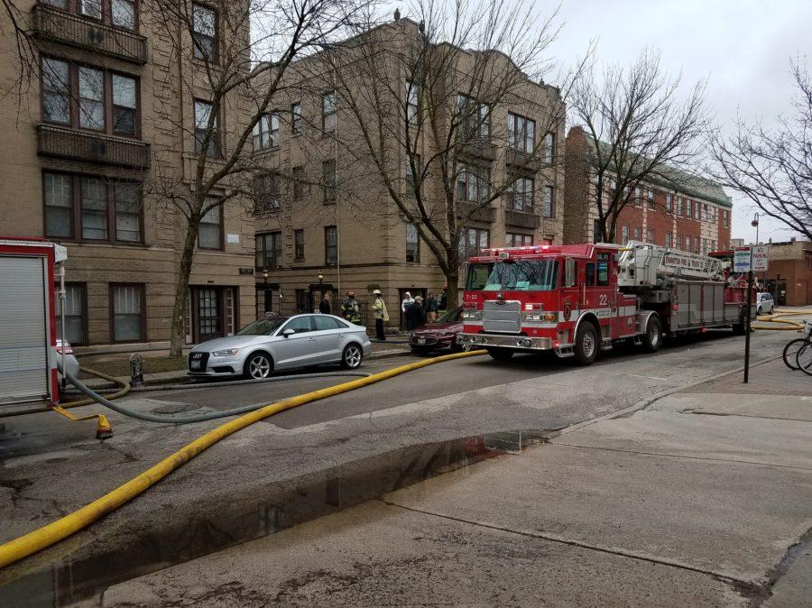 Firefighters work to stop a fire in south Evanston on Friday.