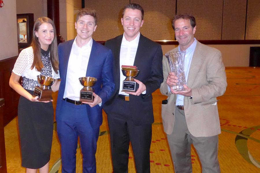 Members of NU's Pritzker School of Law team Stacy Kapustina, Garrett Fields and Douglas Bates, and coach Richard Levin pose with awards. The team won their fifth National Trial Competition championship title in Fort Worth, Texas.