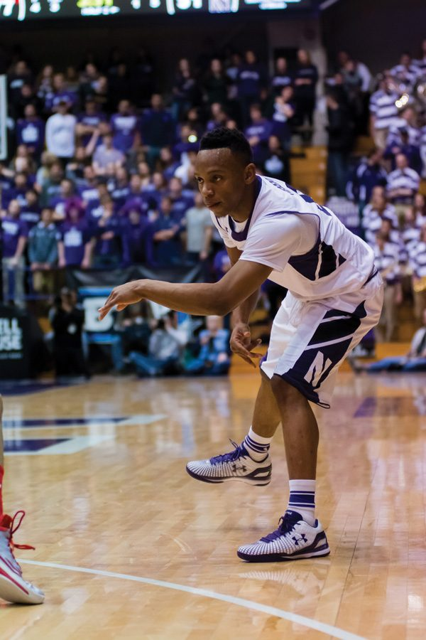Johnnie Vassar makes a pass. The former NU basketball player filed a motion Tuesday opposing a separate motion to dismiss his lawsuit against the University.