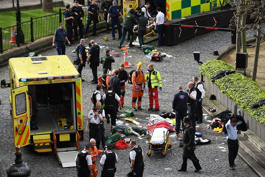 Emergency services on Wednesday, March 22, 2017 at the scene outside the Palace of Westminster, London, after a policeman was reportedly stabbed and his apparent attacker shot by officers in a major security incident at the Houses of Parliament.